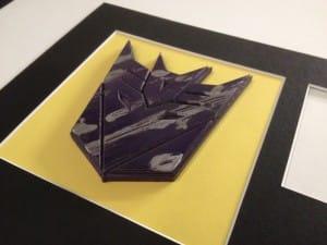 Large Decepticon badge on yellow background