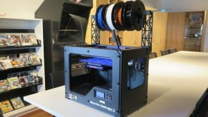 TRON - LATD's Makerbot Replicator 2 with his new overhead filament gantry