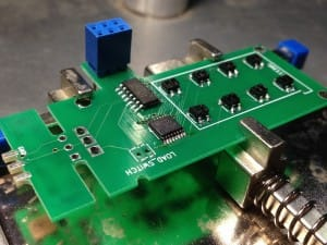 Flip side of the board, chips and sensors mounted using a board vice