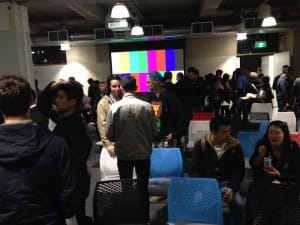 People getting ready to see and hear the product pitches at the final event